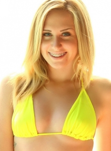 Sexy Blonde Ashley Vallone Teases As She Slowly Strips Out Of Her Skimpy Yellow Bikini Top - Picture 2
